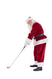 Santa Claus is playing golf stock photography