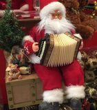 Santa Claus. Playing music instrument Stock Photography