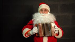 Santa Claus plays the accordion