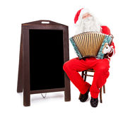 Santa Claus plays the accordion Royalty Free Stock Photography