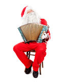 Santa Claus plays the accordion Stock Photos