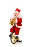 Santa Claus plays the saxophone on bicycle Royalty Free Stock Photo