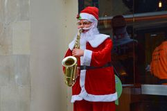 Santa Claus plays a saxophone Royalty Free Stock Images