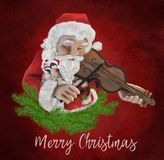 Santa Claus plays the violin. With two loving birds Royalty Free Stock Photos