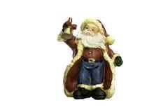 Santa Claus-pleistermodel met kleine klok in hand op achtergrond Stock Foto's
