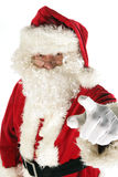 Santa claus is pointing. Santa claus on white background is pointing at something Royalty Free Stock Photo