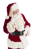 Santa Claus Pointing Against White Background Stock Foto's
