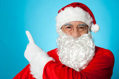 Santa claus pointing away Stock Photo