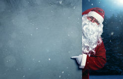 Santa Claus pointing on the banner Royalty Free Stock Images