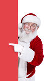 Santa claus pointing at blank banner Stock Photo
