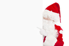 Santa Claus pointing at blank banner Royalty Free Stock Photos