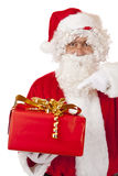Santa Claus pointing on Christmas gift box Royalty Free Stock Image
