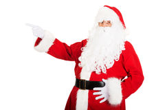 Santa Claus in pointing gesture Royalty Free Stock Images