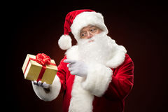 Santa Claus pointing on gift box Stock Photography