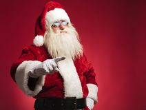 Santa claus pointing his finger to draw attention Royalty Free Stock Photography