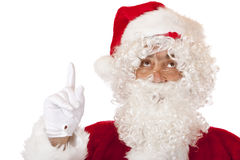 Santa Claus is pointing with his finger to the top Royalty Free Stock Images