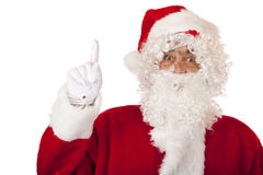 Santa Claus is pointing with his finger to the top Royalty Free Stock Photography