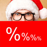 Santa Claus. Pointing in red blank sign with smile, isolated on background Stock Photos
