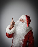 Santa Claus is pointing Stock Images