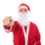 Santa Claus pointing to the beholder, isolated on white. Concept christmas Royalty Free Stock Photo