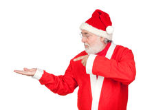 Santa Claus pointing to the outstretched palm Stock Photography