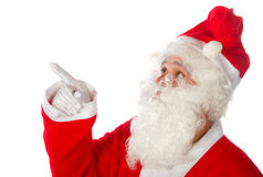 Santa Claus pointing upwards Royalty Free Stock Images
