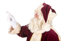 Santa Claus pointing upwards Stock Photo