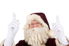 Santa Claus pointing upwards Stock Images