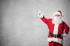 Santa Claus pointing on a wall Royalty Free Stock Photography