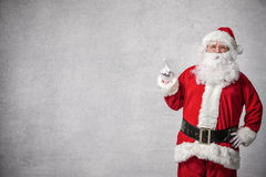 Santa Claus pointing on a wall Royalty Free Stock Photos