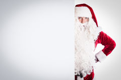 Santa Claus pointing in white blank sign Royalty Free Stock Image