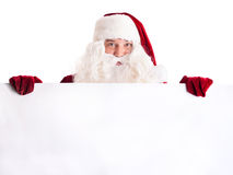 Santa Claus pointing in white blank sign Royalty Free Stock Photos