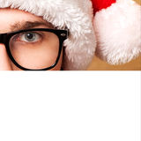 Santa Claus pointing in white blank sign Stock Photo