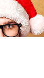 Santa Claus pointing in white blank sign Royalty Free Stock Photo
