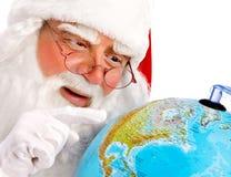 Santa Claus Points på jordklotet Royaltyfria Bilder