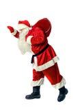 Santa Claus porta una borsa con i regali Immagine Stock
