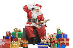 Santa Claus Portrait checking his list Royalty Free Stock Image
