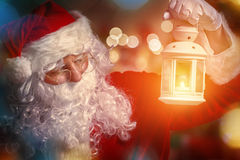 Santa Claus. Portrait of Santa Claus with lantern in hand royalty free stock photo