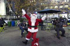 Santa Claus poses outside of Herald Square NYC Stock Image