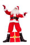 Santa Claus posing with Christmas gift Stock Photography