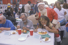 Santa Claus posing with the homeless Stock Image
