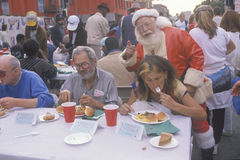Santa Claus posing with the homeless for Christmas dinner, Los Angeles, California Stock Photos