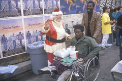 Santa Claus posing with homeless men for Christmas dinner, Los Angeles, California Royalty Free Stock Photography