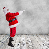 Santa Claus posing  on wooden background Royalty Free Stock Image
