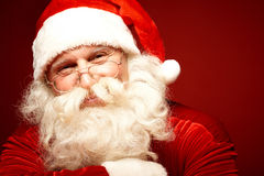 Santa Claus. Positive Santa Claus in eyeglasses looking at camera with smile Stock Photography