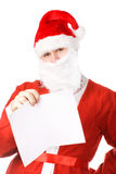 Santa Claus with postcard Royalty Free Stock Image
