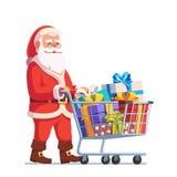 Santa Claus poussant le caddie complètement des cadeaux Photo stock