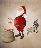 Santa Claus prepara presentes Fotografia de Stock