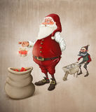 Santa Claus prepares gifts Stock Photography