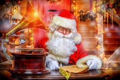 Writing letters to children. Santa Claus is preparing for Christmas. He writes letters. House of Santa Claus. Christmas decoration stock photography